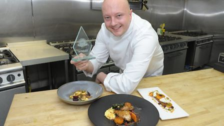 Rhys Richardson, development chef at Servest Catering, with his Blue Arrow Chef of the Year trophy.