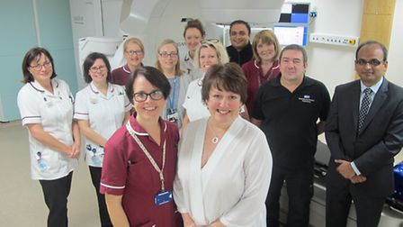 Veronique Mackay, pictured with Keir Williamson, specialist breast therapeutic radiographer, who, a