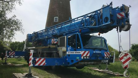 A crane was used to lift the renovated cap back into place on top of Billingford Mill, near Diss. It