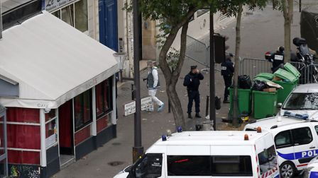 Investigators and police work outside the Bataclan concert hall, Saturday, Nov. 14, 2015 in Paris. F