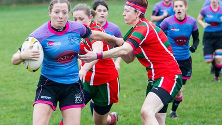 Claire Brickley hands off for Woodbridge Amazons