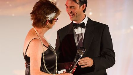 Harrod UK sales and marketing manager from Harrod UK, Kevin Utton with award winner Val Bentley at