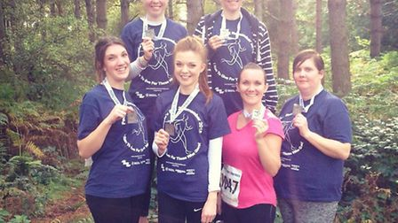 Christies Care staff after with medals: front row, Sophie Emmerson, Kristy Nickels, Sarah Rampling,
