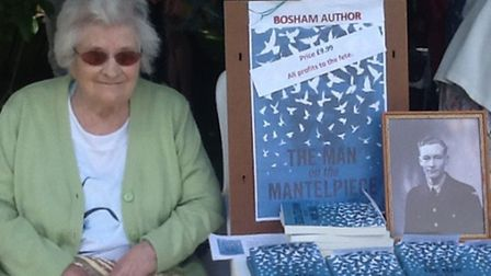 Pat with copies of her daughter's book