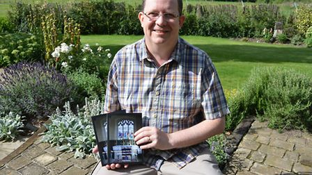 Andy Pritchatt with his book Ufford and the Great War. He says: 'With the number of names and the in