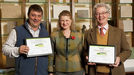 From left, James Waters, leader of Forest Heath District Council with the authority's Carbon Charter