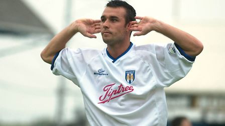 Scott McGleish, back in his Colchester Unioted days, responds to the jeers from Peterborough fans ba