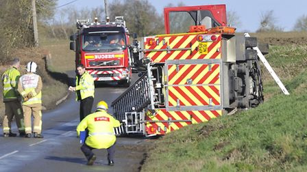 A fire engine overturned on Lower Road in Onehouse after hitting a patch of ice on the way to an acc