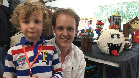 Lego show organiser Tom Hadfield with his son Tommy Jnr at Bressingham Bricks near Diss. Picrture: S