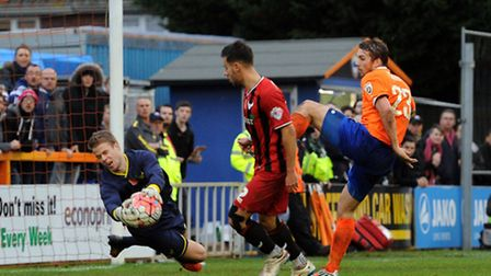 Braintree Town v Oxford United - FA Cup action. Oxford keeper Benji Buchel get the ball but fumbles
