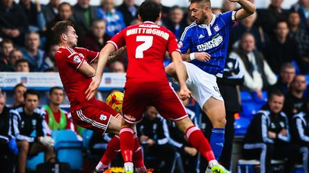 Luke Chambers battles early on in the Ipswich Town v Cardiff City (Championship) match at Portman R