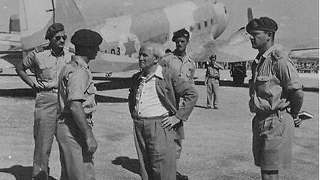 Tom Bowden, 1st commander of the Paratrooper School, pictured standing behind Israeli Prime Minister