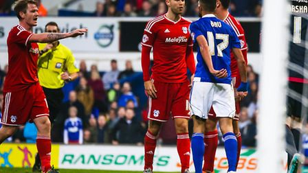 Cardiffs Matthew Connolly and Towns Kevin Bru square up to each other, ahead of the Ipswich players