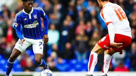 Ainsley Maitland-Niles looks for a way past Emyr Huws during the Ipswich Town v Huddersfield Town (C