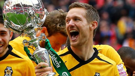 Ian Miller wins the FA Trophy with Cambridge United in 2014.