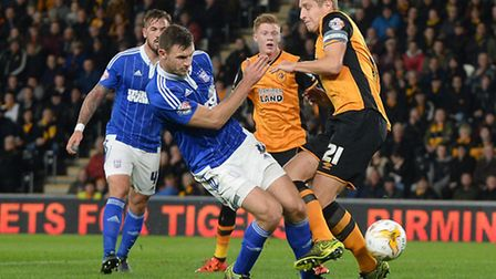 Tommy Smith clashes with Michael Dawson in the penalty area at Hull