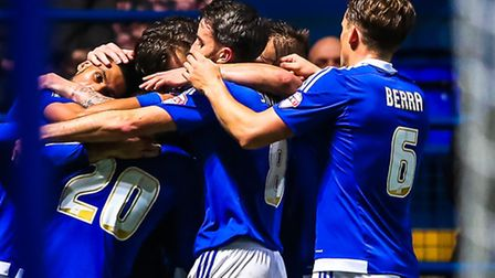Town players surround Brett Pitman after he had scored Towns second goal during the Ipswich Town v B