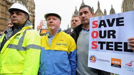 Members of the Unite union and Tata Steel workers gather in Parliament Square, London, ahead of a pr