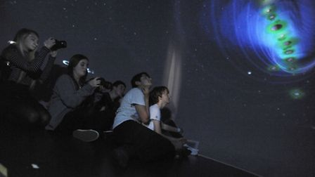 The STEM science week at West Suffolk College in Bury. Students inside the planetarium.