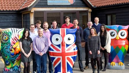 """Staff at the Claydon offices of roadsurfacing firm Toppesfield with the company's three """"Big Hoot"""" o"""
