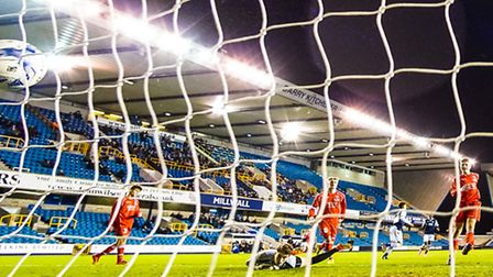 Lewis White beats Woodbridge Town Keeper Alfie Strong for Millwall's with goal in the Millwall v Woo