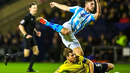 Michael Cheek fires in an early shot during the Oxford United v Braintree Town (Emirates FA Cup) mat
