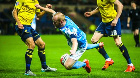 Kenny Davis goes down under pressure during the Oxford United v Braintree Town (Emirates FA Cup) mat