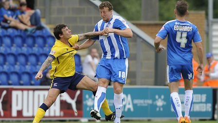 Tom Eastman (heading the ball) limped off during Colchester's 3-1 defeat to Coventry City on Saturda