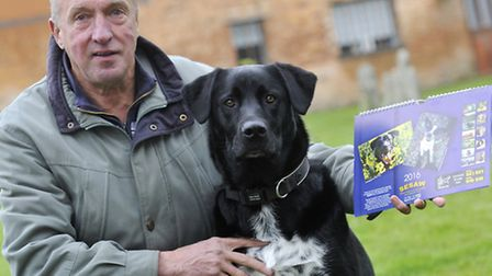 Don Cox's three year-old rescue dog Bowza is featured on the cover of animal rescue centre SESAW's c