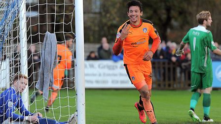 Macauley Bonne celebrates scoring Colchester United's third goal in a 6-2 win at Wealdstone in the F