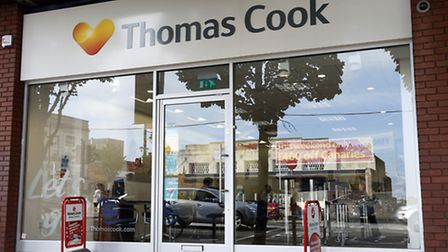 Thomas Cook has reported its first annual profit for five years.