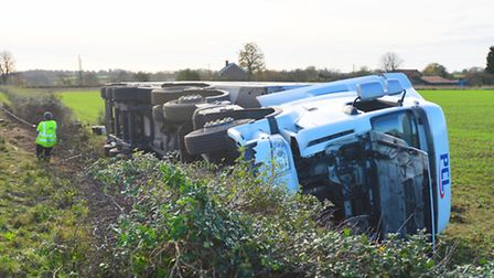 Police have closed the A134 near Bradfield Combust to recover a turned over lorry.