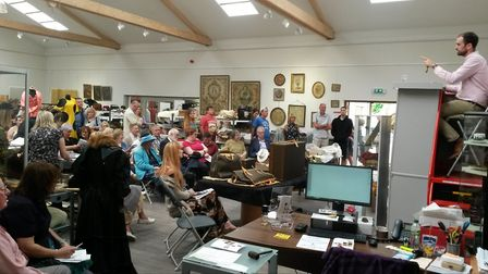 Bidders at the vintage fashion and furnishings sale in Diss where 1950s Louis Vuitton bags sold for