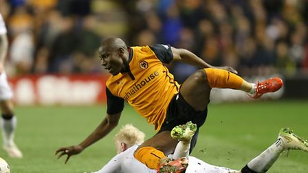 Wolverhampton Wanderers' Benik Afobe (above) and Derby County's Will Hughes battle for the ball duri