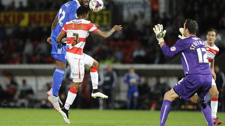 James Alabi, left, in action at Doncaster Rovers