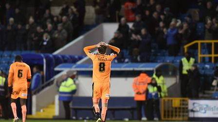 Alex Gilbey leaves the pitch after Colchester's defeat at Millwall