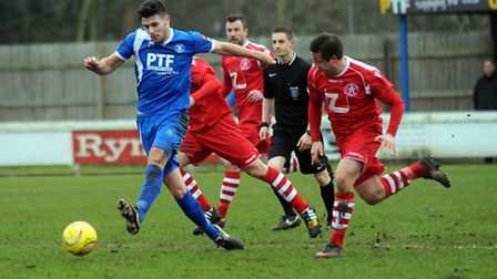 Connor Hall (blue) in action for Bury Town last season. The midfielder has just re-signed from St Ne