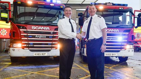 Acting Chief Fire Officer Adam Eckley of ECFRS and Paul Fuller, Chief Fire Officer at BFRS, celebrat