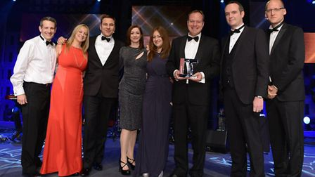From left, Lee Boswell of Alan Boswell Group ( ABG), Sharon Theobold, ABG, ceremony host David Wall