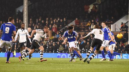 ainsley maitland-niles shoots during the second half at fulham