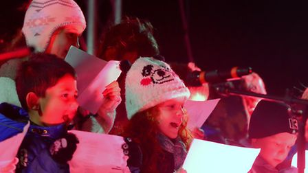 Pupils from Aldeburgh Primary School sing during the Christmas light switch on event.