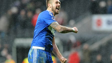 Luke Chambers with his customary celebration after a match win this time at Stadium MK