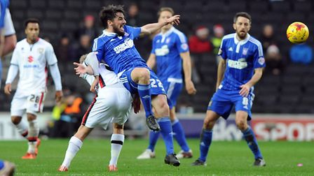 Jonathan Douglas being held at MK Dons in the early game on Saturday