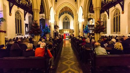 Members of the congregation sing during the Concert of Carols 2014 at St Mary-le-Tower Church, Ipswi