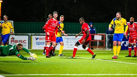 Luke Callander has this effort saved during the Harlow Town v AFC Sudbury (Ryman League Division One