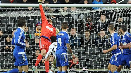 Dean Gerken keeps Ipswich in front at MK Dons tipping the ball over the bar