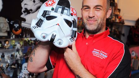 Star Wars fanatic Jason Buxton with his massive collection of items from the film franchise.