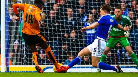 Christophe Berra steps in to clear a Dominic Iorfa shot early in the Ipswich Town v Wolverhampton Wo