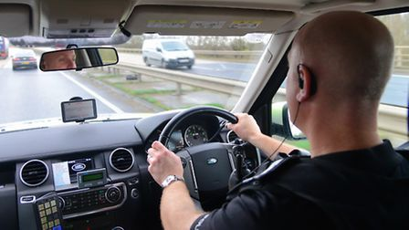 Inspector Julian Ditcham on patrol along the A14 checking for motoring offences.