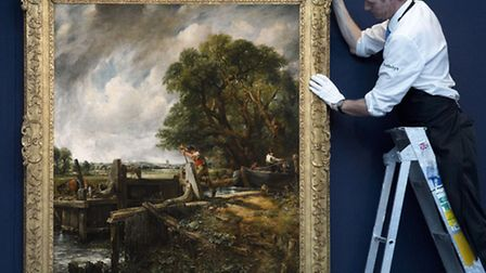 A Sotheby's gallery technician hanging The Lock by John Constable, which sold for �9.1m. Photo: Soth
